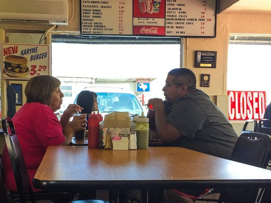 Diners enjoy lunch Friday at Papa Burgers on Piedras