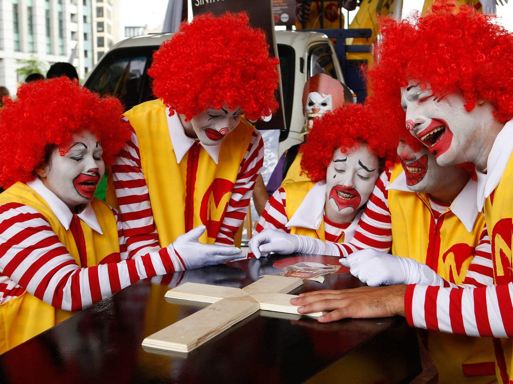 Demonstrators dressed as Ronald McDonald participate in a protest against the U.S. fast food chain McDonald's on April 15 in Sao Paulo, Brazil. The protest is part of a global mobilization against McDonald's for alleged exploitation of workers.