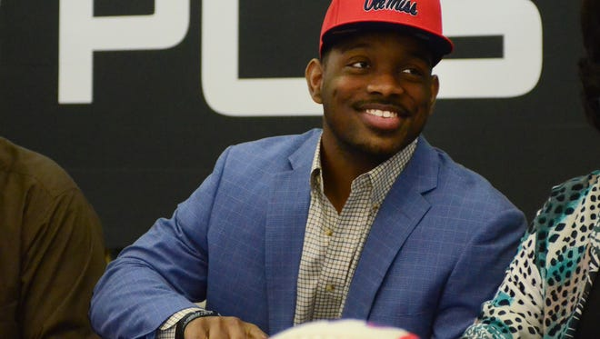 PCS running back Isaiah Woullard smiles before signing with Ole Miss Wednesday.