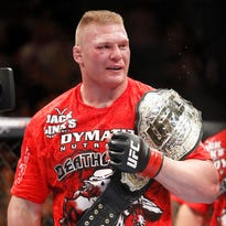 ORG XMIT: _55C7588.JPG Brock Lesnar celebrates his UFC heavyweight mixed martial arts title match win against Shane Carwin Saturday, July 3, 2010, at The MGM Grand Garden Arena in Las Vegas. (AP Photo/Eric Jamison)