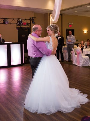 Greta Perske dances with Danny Daniels -- her marrow donor when she was undergoing treatment for leukemia in 2007 -- at her wedding reception Oct. 10 at Kelly Inn in St. Cloud.