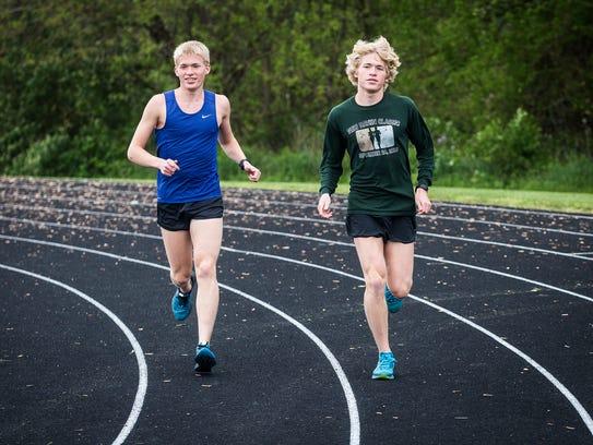 Wapahani's Alex and Nathan Herbst run on the track