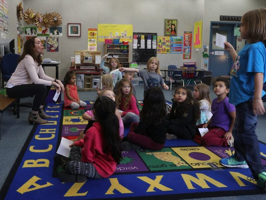 Shannon Shelburne, left, a teacher, at Sycamore Elementary School in Redding, teaches kindergartners Spanish Tuesday at the school in Redding.