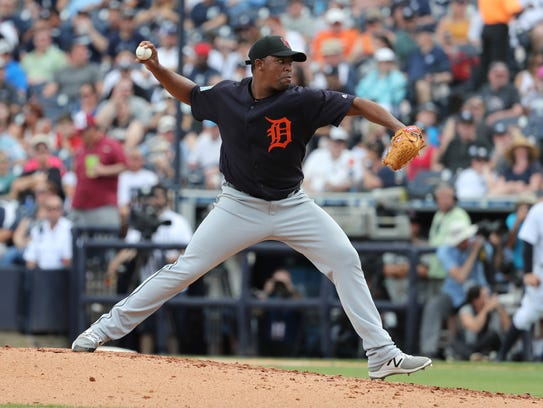 Tigers relief pitcher Gerson Moreno (60) throws a pitch