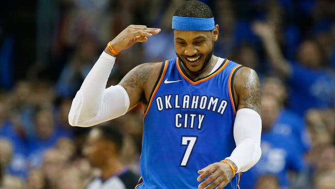 Oklahoma City Thunder forward Carmelo Anthony (7) gestures after hitting a three-point basket in the second quarter of an NBA basketball game against the New York Knicks in Oklahoma City, Thursday, Oct. 19, 2017.