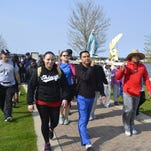 Pilgrims carry banners and a crucifix as they pass underneath the Ray Nitschke Memorial Bridge in downtown Green Bay during the fourth annual Walk to Mary on Saturday morning, May 7, 2016. The 21-mile walk from De Pere to The Shrine of Our Lady of Good Help in Champion included 1,050 people from 15 states.