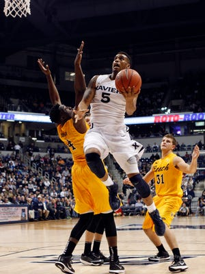 Xavier Musketeers forward Trevon Bluiett (5) drives to the basket during the first half against the Long Beach State 49ers at Cintas Center.