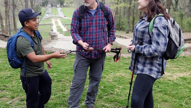 Dawa Jangbu Lama Sherpa, far left, talks with Mark and Holly Johnson about hiking gear at Percy Warner Park Friday March 31, 2017.