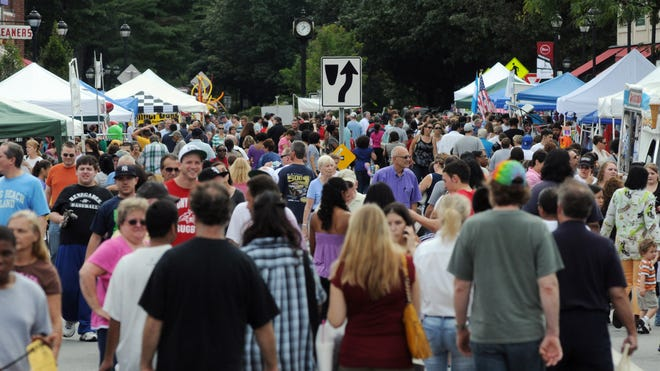 The Arlington Street Fair filled Raymond Avenue with people during the 2011 event.
