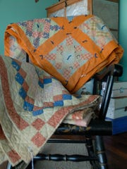 Pictured are quilts made by the photographer's great-great-grandmother,