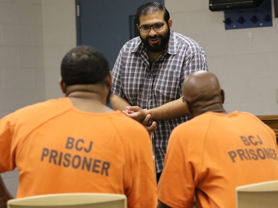 Imam Mohammed Ibn Ahmed speaks with Muslim inmates