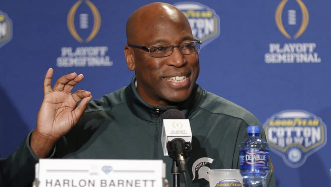 Michigan State defensive coordinator Harlon Barnett gives an opening statement during a news conference for the NCAA Cotton Bowl college football game against Alabama, Sunday, Dec. 27, 2015, in Dallas. (AP Photo/Brandon Wade) ORG XMIT: TXBW111