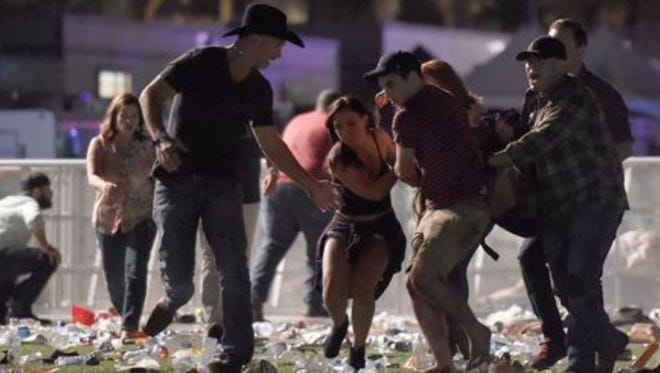 Festival goers rush out after shots are fired at the Route 91 Harvest Festival during Jason Aldean's performance.