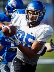 University of Memphis reciever Tre'Veon Hamilton makes a catch during spring football practice.