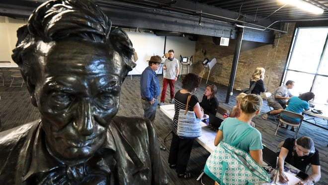 A statue of Abraham Lincoln watches over primary-election voters in Salt Lake City on June 26, 2018.