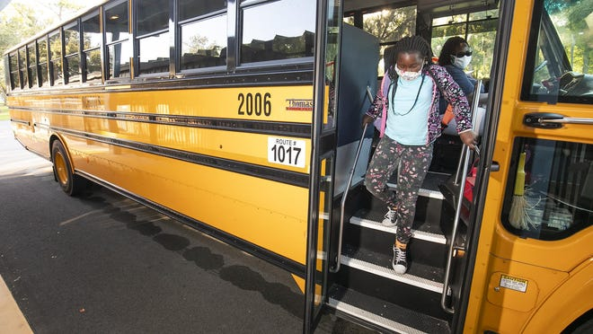 Shakira Gray, 9, exits the bus after arriving at Evergreen Elementary School on Monday. About 1,000 students in Marion County attended LIftoff 2020 at 50 schools on Monday.