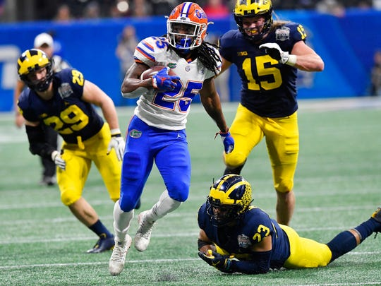 Florida running back Jordan Scarlett runs against Michigan during the second half of the Peach Bowl.