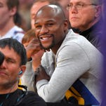 Boxer Floyd Mayweather Jr. watches the Los Angeles Lakers play the Phoenix Suns in December in Los Angeles. Mayweather had something to say about his recently secured fight with Manny Pacquiao.