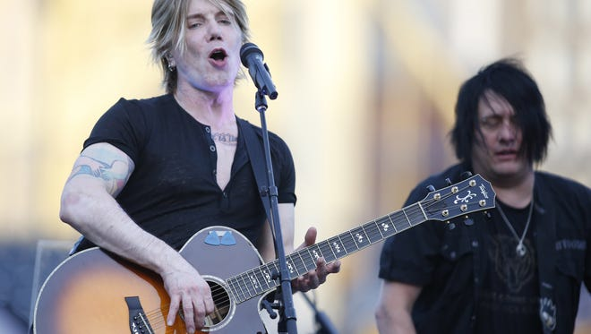 Performing artists John Rzeznik (left) and Robby Takac (right) of the band Goo Goo Dolls perform during a post-game concert in 2014.