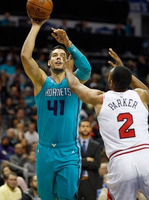 Charlotte Hornets' Willy Hernangomez (41) looks to shoot over Chicago Bulls' Jabari Parker (2) during the first half of an NBA basketball game in Charlotte, N.C., Friday, Oct. 26, 2018. (AP Photo/Bob Leverone)
