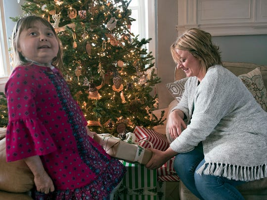 Reese Burdette spends time with her mother, Claire, around the Christmas treet at her Mercersburg home. Burdette recently received a new kidney and is back home, getting ready for the holidays.