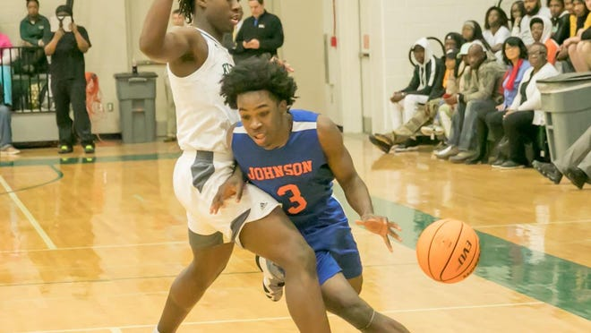 Johnson's Emondre Bowles drives toward the basket while being blocked by Windsor Forest's Jaquan Kearse early in game last season at Windsor Forest.
