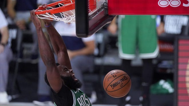 The Celtics' Jaylen Brown celebrates as he dunks against the Heat during the Saturday night's Eastern Conference final playoff basketball game. ]AP / Mark J. Terrill]