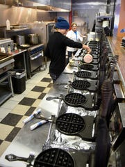 Employees prepare a new order at Waffle-It Wednesday,