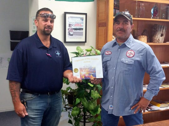 Frank Luna, at right, was recognized as employee of the quarter for Public Works/Infrastructure. Water Distribution Director Adam Sanchez is at left.