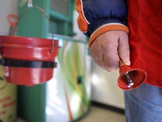 A Salvation Army bell ringer greets shoppers at Smith's