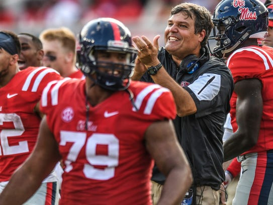 Mississippi interim head coach Matt Luke reacts after