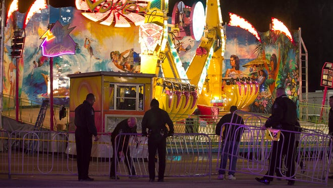 Police secure a barricade around the 'Vortex' ride after an accident closed the ride on Oct. 24, 2013, at the N.C. State Fair in Raleigh.