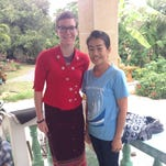 Bethany Schumacher, left, poses with her host mom in Bang Rachan, Thailand. Schumacher's host mom had her try on a traditional Thai wrap skirt, called a passin, and a traditional shirt before a cultural event. Schumacher, a Menasha native, is serving 27 months in the Peace Corps.