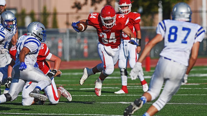 Lincoln's Cory Fichter (34) rushes with the ball during a game against Rapid City Stevens Saturday, Aug. 27, 2016, at Howard Wood Field in Sioux Falls.