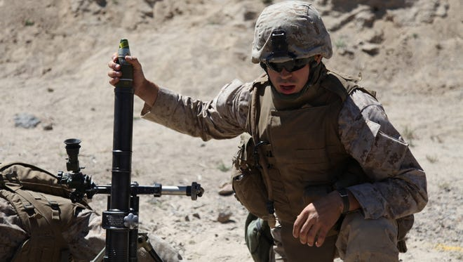 A Marine loads a 60mm mortar during a training exercise.