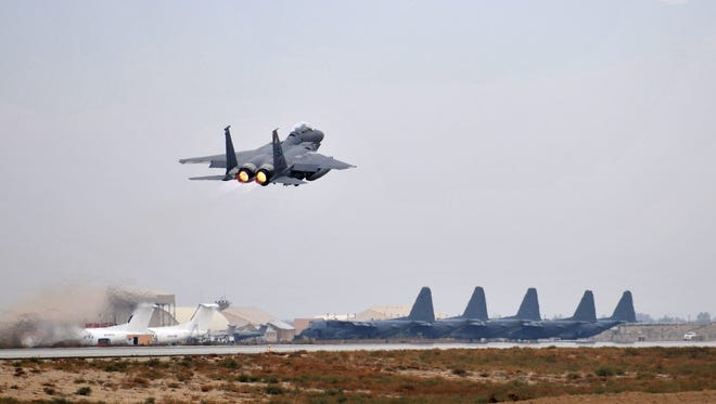 A file handout picture taken on Nov. 17 2011 shows aircraft from the 335th Expeditionary Fighter Squadron at Bagram Airfield, near Kabul, Afghanistan.