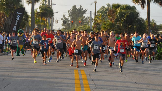 More than 1,600 people participated in the 2015 Cocoa Beach Turkey Trot Thanksgiving morning, complete with costumed runners, a serious downpour and a rainbow at the finish line.