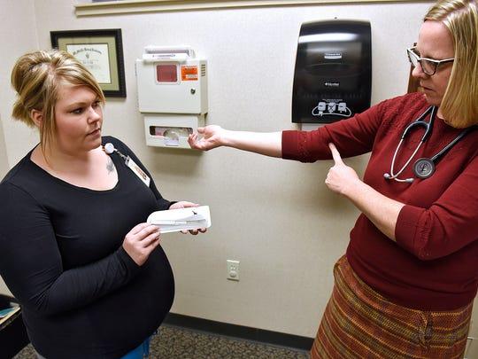 Nurse Megan Holderness and Dr. Julie Anderson talk