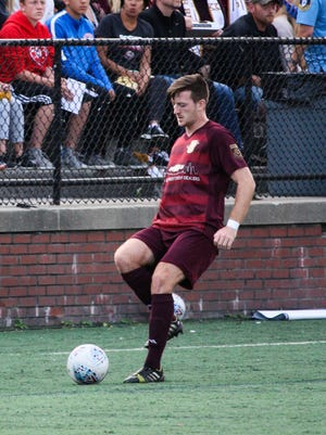 Detroit City FC's Stephen Carroll dribbles the ball during the NPSL semifinal match against Midland-Odessa FC on Saturday, Aug. 5, 2017 in Hamtramck.