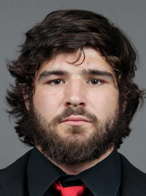 This photo taken on Sept. 11, 2013, and provided by Ohio State University shows college football player Kosta Karageorge in Columbus, Ohio.  The 6-foot-5 senior missed football practice Wednesday and Thursday and has not been heard from since Wednesday morning.