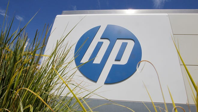 In this Aug. 21, 2012, file photo, the Hewlett-Packard Co. logo is seen outside the company's headquarters in Palo Alto, Calif.