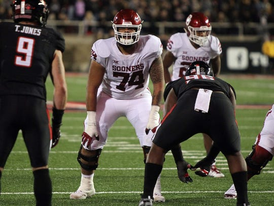 Oklahoma offensive tackle Cody Ford gets ready to play before a snap against Texas Tech.