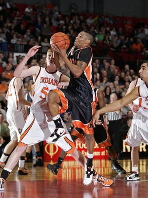 Peoria Manual's Marvin Jordan (4), who made a game-saving 3-pointer with 2.9 seconds left, tries to drive past Winnebago's Chas Cross (53) in the 2010 Class 2A supersectional at NIU. [SCOTT MORGAN/ROCKFORD REGISTER STAR].