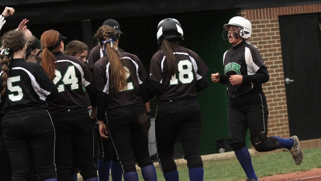 Clear Fork's Haylie Miller is congratulated by her fellow teammates after hitting a home run during a game against Galion on Wenesday.
