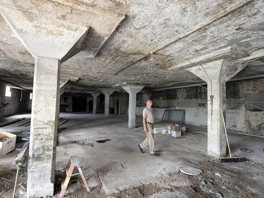 NeighborWorks project manager Tim Denissen inspects the interior of the armory building on Chicago Street that is under consideration for an urban farming operation.