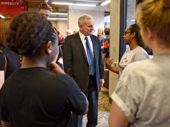 Gov. Mark Dayton speaks with people following a press conference on funding for the Minnesota State Colleges and Universities system Friday at St. Cloud State University.