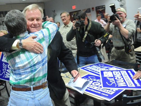 Scott Wagner embraces his sister Sue Wagner as he comes in to speak to supporters at a York baseball stadium on Tuesday, March 18, 2014.
