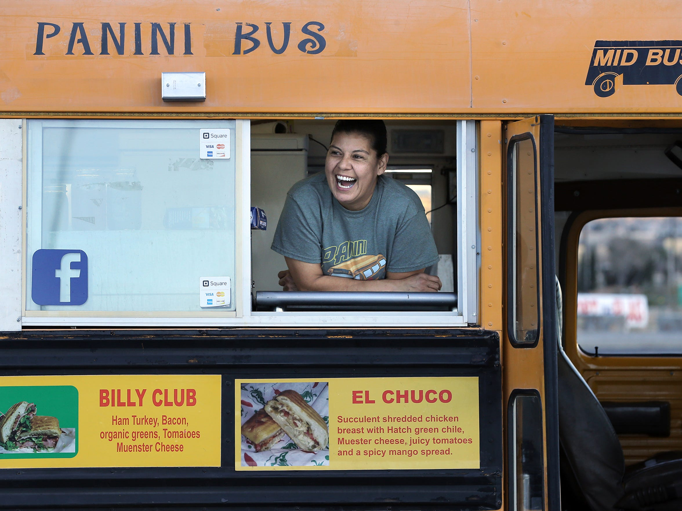 Panini Bus owner Cynthia Bertoldo jokes with customers from the window of her food truck on a Thursday night at the Old Glory Memorial in northeast El Paso.
