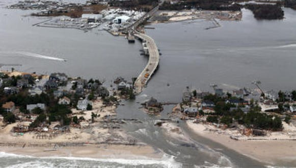 Coastal damage and flooding in Mantoloking two days