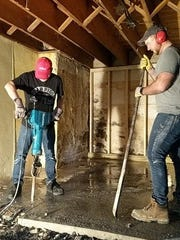 Rob Gustafson and Jake Rohde dig drainage for the brewhouse